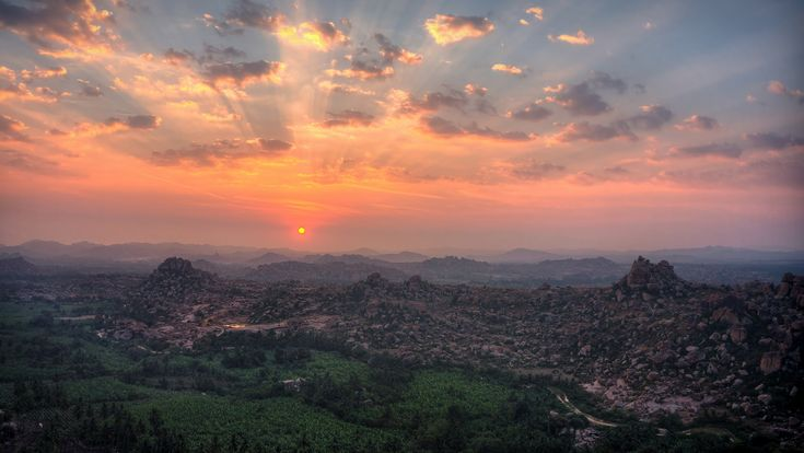 https://flic.kr/p/qmEY7W | Sunrise at Matanga - Hampi | Trekked early morning over the Matanga Hill to catch a glimpse of this beautiful sunrise. Matanga Hill has 360 degree of entire Hampi which is best seen during sunrise. I think, if anyone goes to Hampi, this is the best thing that they would take back home :)