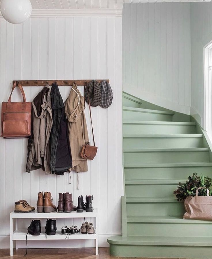 Farmhouse style foyer and stairwell.