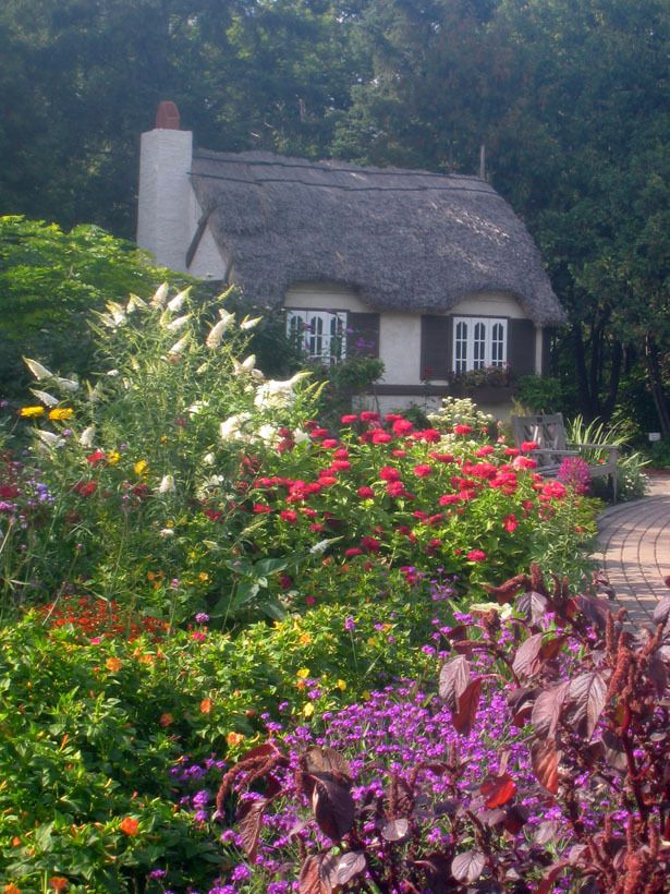 The gardens of Assiniboine Park include the English Garden with its Crofter's Cottage.  Winnipeg, Manitoba, Canada.  by Liz Primeau