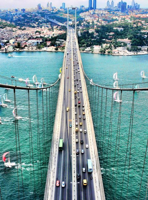 The Bosphorus Bridge in Istanbul, Turkey. Where east meets west. This bridge is one of the bridges in Istanbul which spans Bosphorus strait, connecting two continents, Europe and Asia... beautiful city ... www.turkishairlines.com