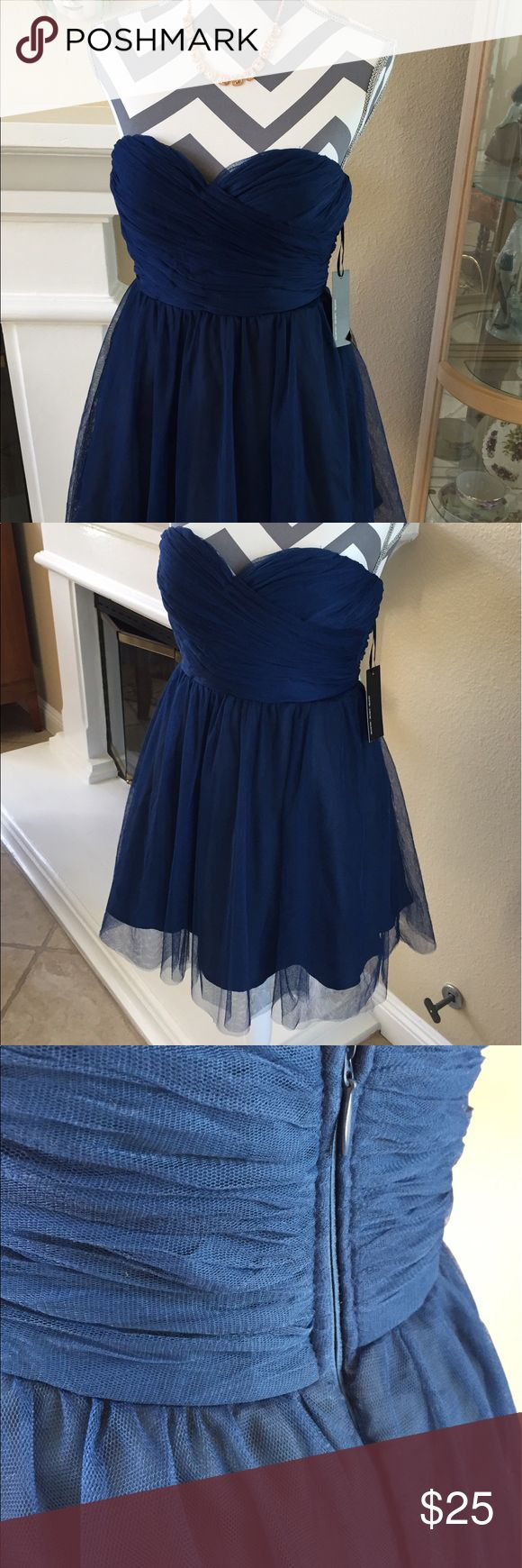 "Navy Tulle Strapless Party Dress Pretty Tulle Strapless party dress with sweetheart neckline. Hidden zipper.  27"" long. Underlace and overlay.  Perfect for a special occasion or night out.  Brand new with tags. Lulu's Dresses Mini"