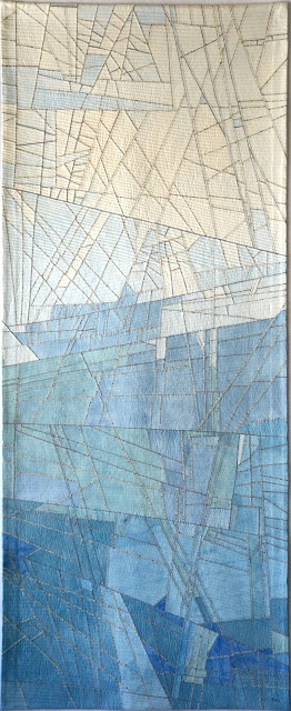 """Kathy Loomis glacier quilt: Last year I was privileged to go to Antarctica. I've always been a lover of cold weather and the big ice we saw, sailed around and walked upon was breathtaking. I was fascinated by the myriad of colors of blue in the ice, the veins of dirt, the complex fracture patterns as chunks cleave and break away. I attempted to depict these fascinations in my quilt """"Big Ice."""""""""""