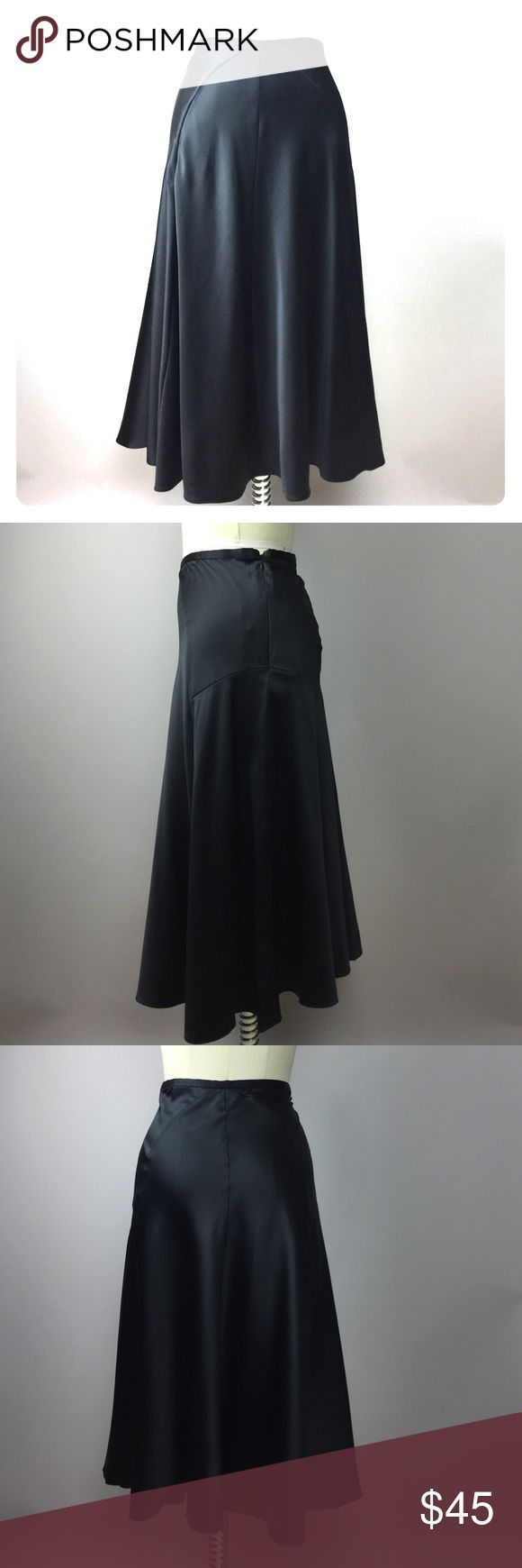 """Calvin Klein Black Silk Midi Skirt 10 So gorgeous! A staple piece every wardrobe needs. Dress it up for career wear or a night out or pair with a tee and some converse for casual wear. 95% silk, 5% lycra. Hidden side zip. 32"""" waist can be worn high or low. 28"""" length. A87M Calvin Klein Skirts Midi"""