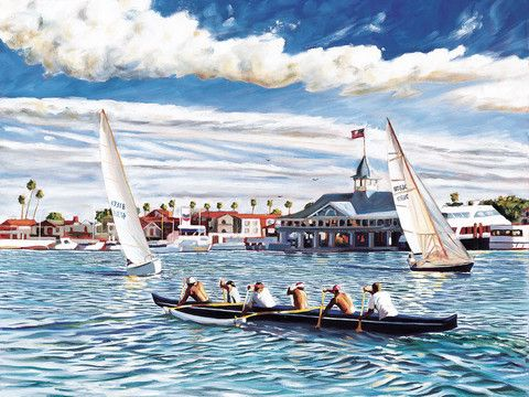 Outrigger and sailboats passing the Balboa Pavilion in Newport Harbor in Newport Beach, California