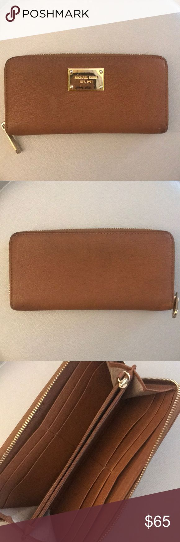 Michael Kors Wallet Michael Kors zip Continental wallet in the color luggage. Wallet features 10 card slots which can be easily doubled up. Slots for cash and coupons and a zippered change purse. MICHAEL Michael Kors Bags Wallets