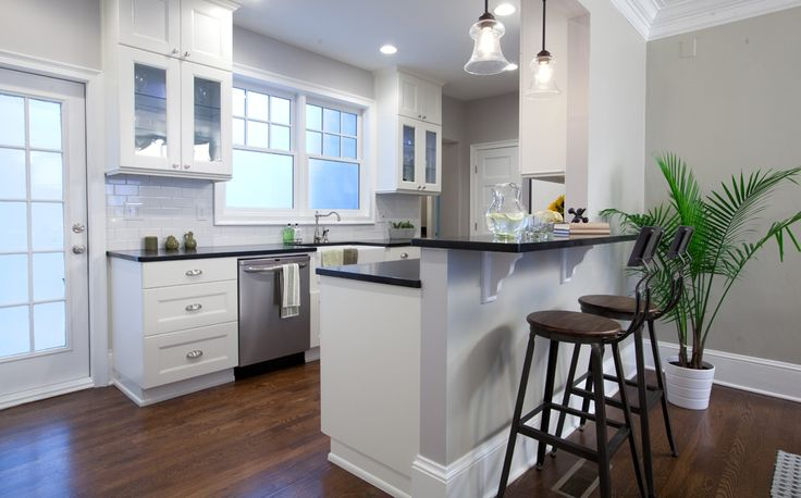 White Cabinets And Black Countertops With White Subway