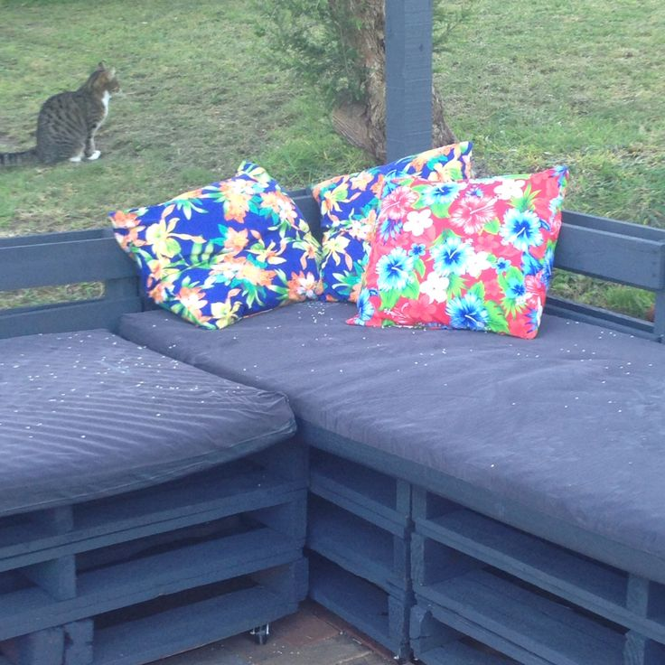 Old pallets made into outdoor lounge. Made the cushion covers too!