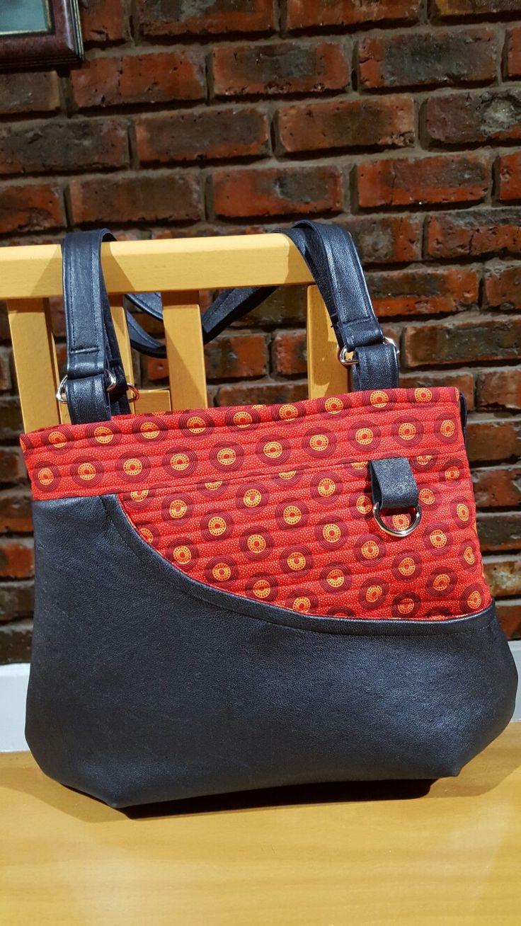 Handmade handbag black leather and red shweshwe