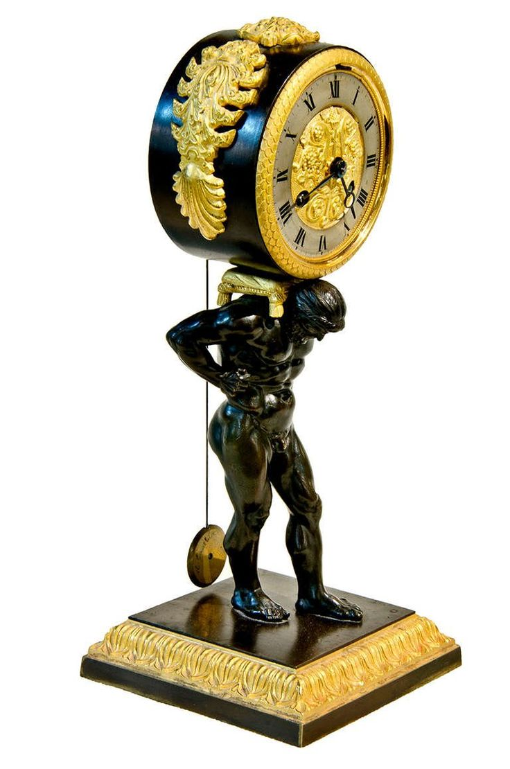 Period Atlas patinated and gilt bronze travel clock with original gilt edged and velvet lined case. Atlas son of Titan, from Greek mythology is holding the clock on his shoulders as if it were the world. c1810