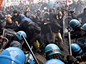 ITALY was plunged into chaos today as anti-Government protesters clashed with riot police in the historic city of Florence.