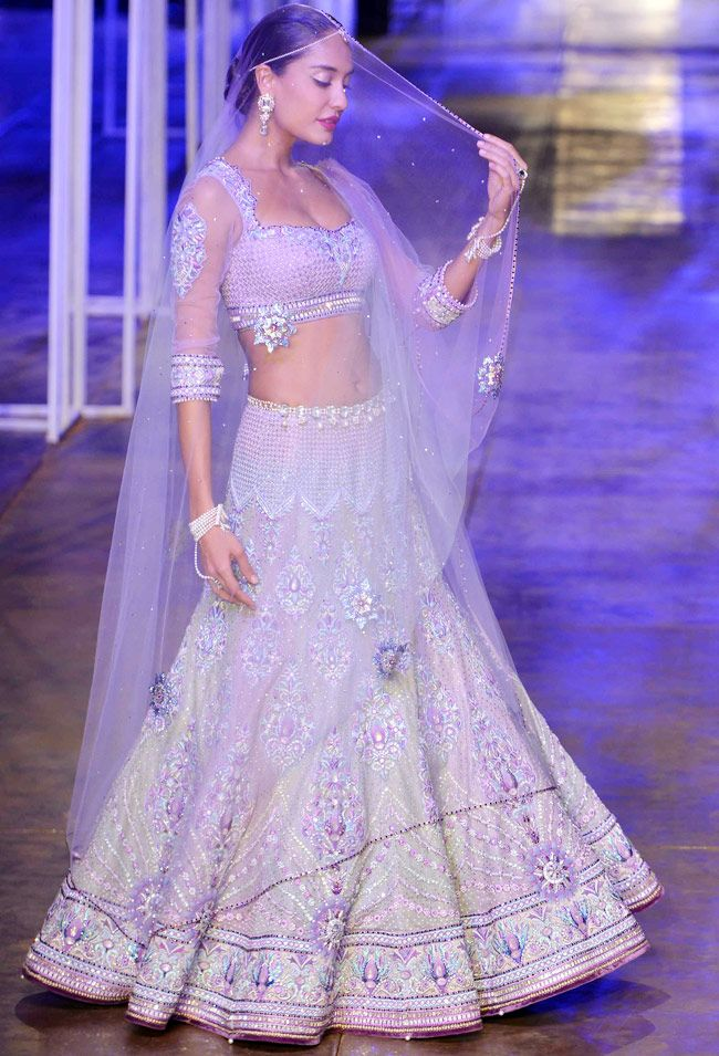 Lisa Haydon looked gorgeous in an elegant silver lehenga which had heavy pearls and Swarovski crystals embellished on it at the grand finale of India Bridal Fashion Week 2013. #Bollywood #Fashion #Wedding