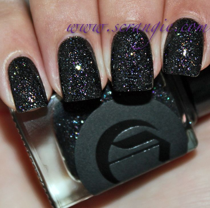 "Ooh la la.. Cirque Colors ""Dark Horse."" A delicious black base with a rainbow of micro glitter! Must find this color"