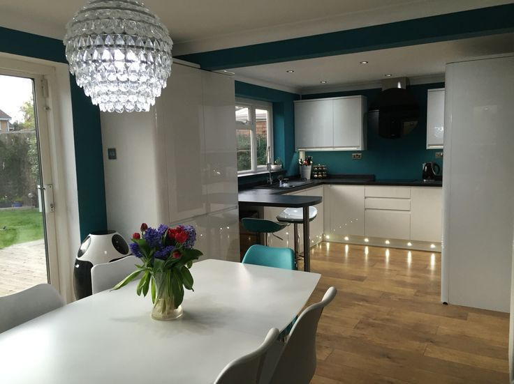 Howdens Clerkenwell kitchen with curves,  Slate basalt worktop , Jade paint, lights, Farrow & Ball Vardo paint