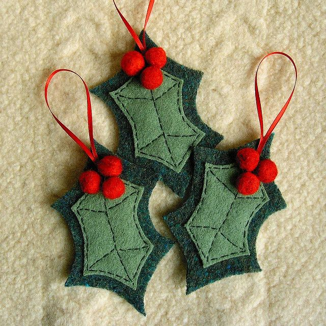 Felt Ornament. ( A good way to use up little scraps of green. And little needle felted red balls.)