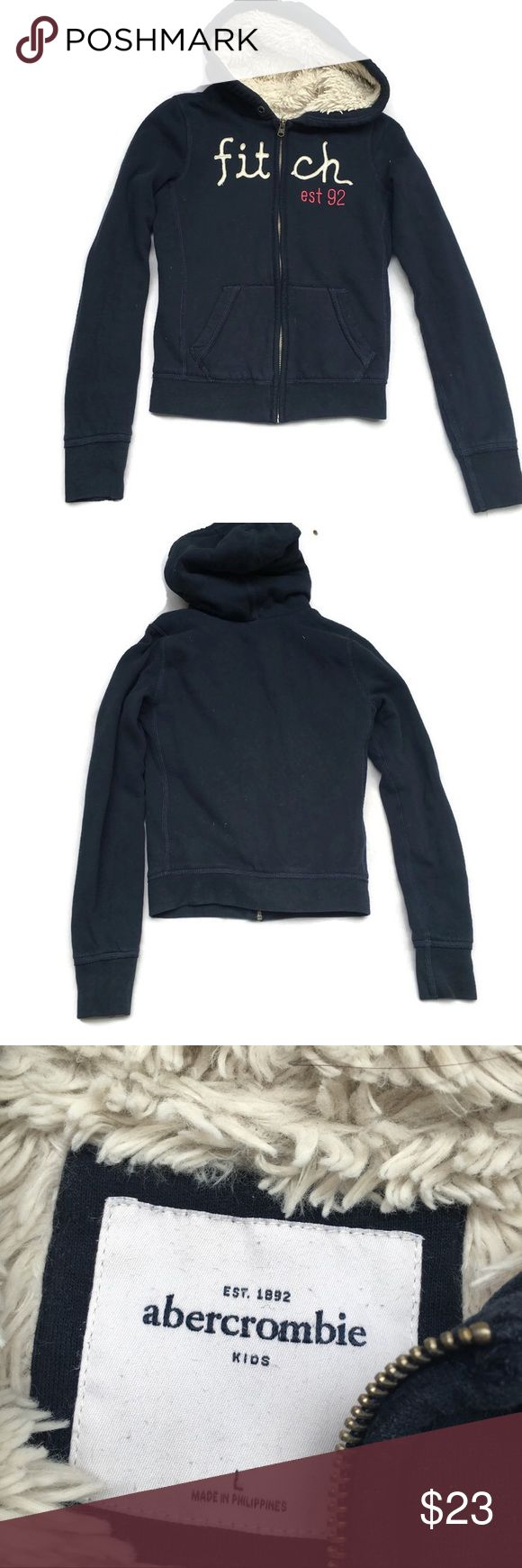 Abercrombie Girls navy blue thick lined hoodie L Abercrombie Girls navy blue thick lined hoodie Size large small stain on hoodie can't even see when worn otherwise great condition from a smoke free home abercrombie kids Shirts & Tops Sweatshirts & Hoodies