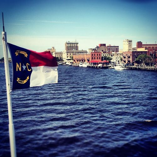 Great shot of downtown Wilmington, NC, from the Cape Fear River. www.SeaCoastRealty.com #wilmingtonnc #skyline #downtown