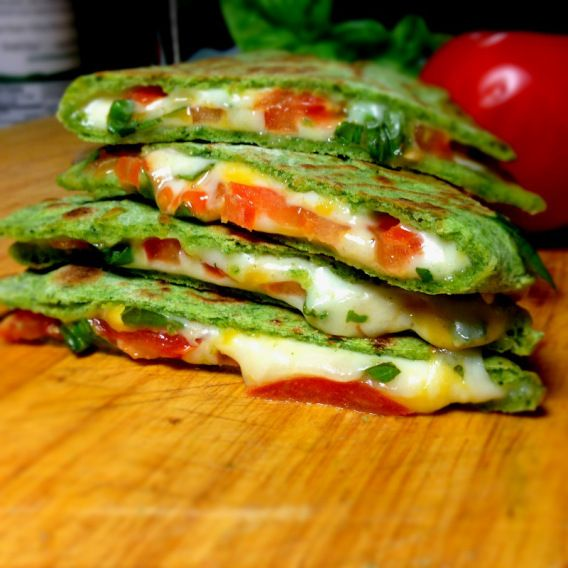 Spinach Quesadilla with Tomatoes and Mozzarella Cheese.  The homemade spinach tortilla is really good.