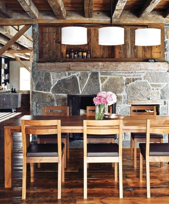 Dining Room With Barn Wood, Stone Wall And Fireplace