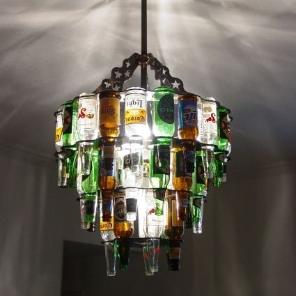 Chandelier from beer bottles...this would be fun to have in a bar area inside or outside!