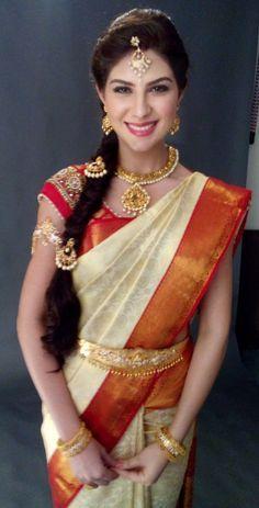 South Indian bride. Temple jewelry. Jhumkis.Cream and orange silk kanchipuram sari with contrast pink blouse.Braid with fresh flowers. Tamil bride. Telugu bride. Kannada bride. Hindu bride. Malayalee bride