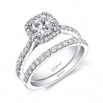 Simple round brilliant diamond ring with a nice halo and a matching wedding band. Marshall Jewelry #haloweddingring