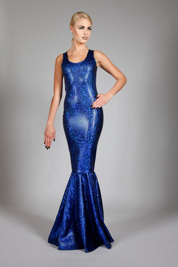 This enchanting holographic royal blue fishtail dress is designed to bring magic to the evening. Sleeveless. Scoop neckline and lower back. The