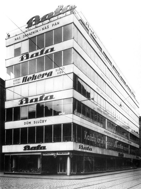 Bata store in Brno, ca 1930. Beside a shoe store the building offered a tire service shop, cleaning, shoe repair and pedicures services. #batashoes
