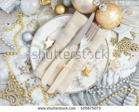 Silver and golden Christmas Table Setting with christmas decorations top view