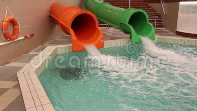 Two water slides green and orange - jets sliding down.