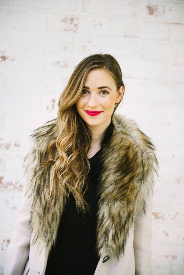 a faux fur collar coat that's perfect for winter