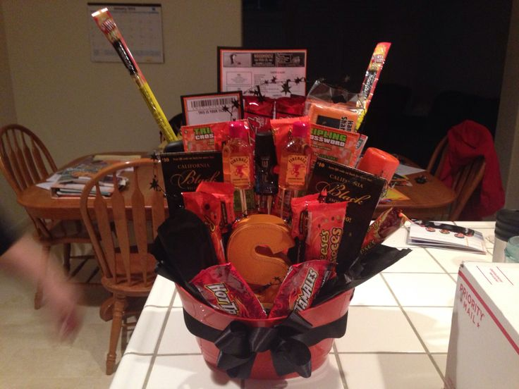Drea's Man Bouquet   Two Sf Giants tickets , voucher for a seafood dinner on the SF Warf, every peanut butter & chocolate candy alive, slim Jim's, axe deodorant , body spray , shaving cream, lotto tickets, and a sham WOW