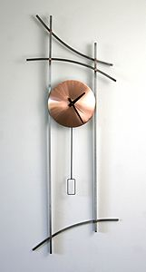 """Asian Wall Clock""  Metal Clock  Created by Julie Girardini and Ken Girardini.           Long steel lines evoke the exotic strokes of Chinese calligraphy; copper face and details. Signed and dated. Uses one AA battery, included."