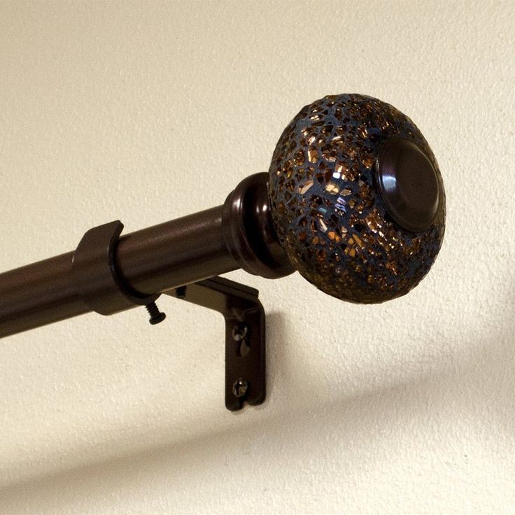 Designed exclusively by Lumino window decor design team. You will love the beautiful high quality finish and material of the Sabrina Mosaic Knob Drapery Single Curtain Rod and Hardware Set. This mosaic knob coordinates with many elegant decor styles and offers an array of color in bronzes and browns as the mosaic material catches the light. Pole finish is dark bronze. 3 Mounting brackets and installation instructions included.