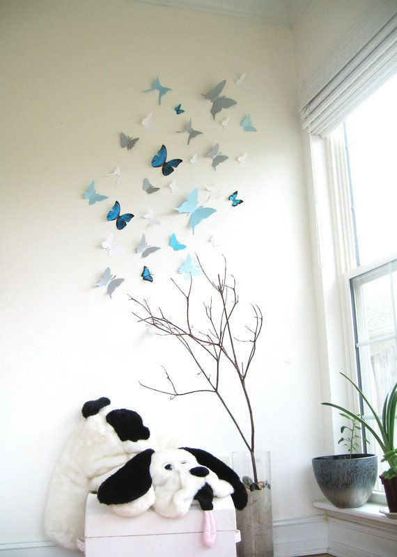 15 3D Wall Butterflies, 3D Wall Decor, 3D Butterfly Wall art, Blue, Silver, White, Nursery, Wedding Decor, Cardstock. $25.00, via Etsy.