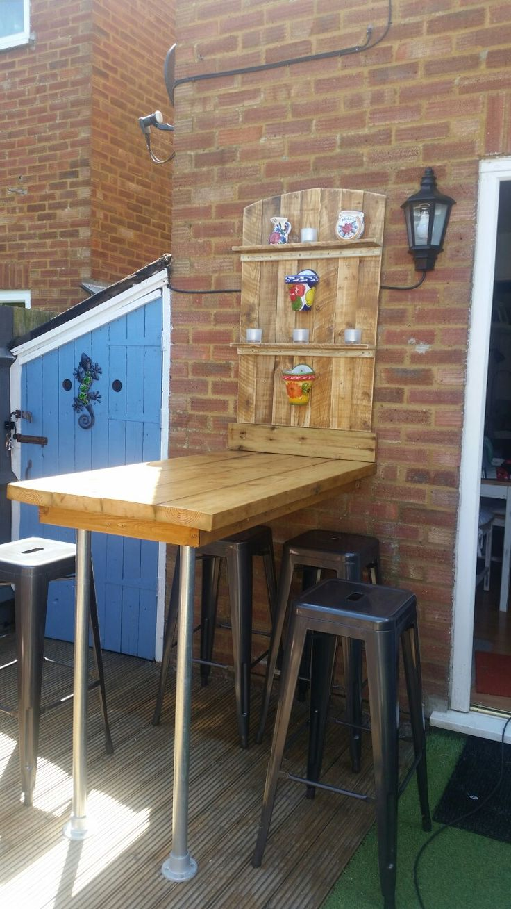 Outside wooden bar, eating area.  Made from pallet wood, scaffold poles and scaffold boards.