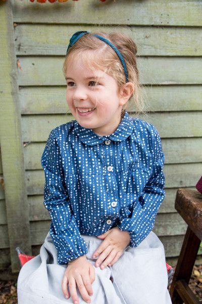 Peter Pan collar Mathilde blouse in navy hearts print. 100% organic cotton, printed in the UK.