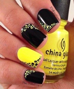 Yellow and black leopard nail art design. The leopard prints are artistically positioned all over the nails creating a fun looking effect on the alternating nails with alternating colors as well.
