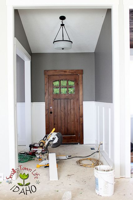 OMG this wood door with board and batten!! LOVE!! Remodelaholic | Inexpensive Board and Batten Wainscot How To