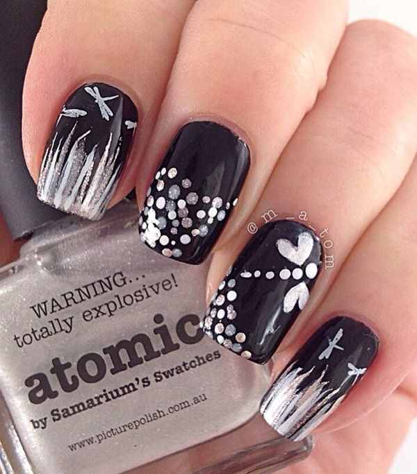 Black polish dragonfly nail art. A very pretty and artistic nail art that uses black, white and glitter colors to complete the mysterious dark effect on the nails.