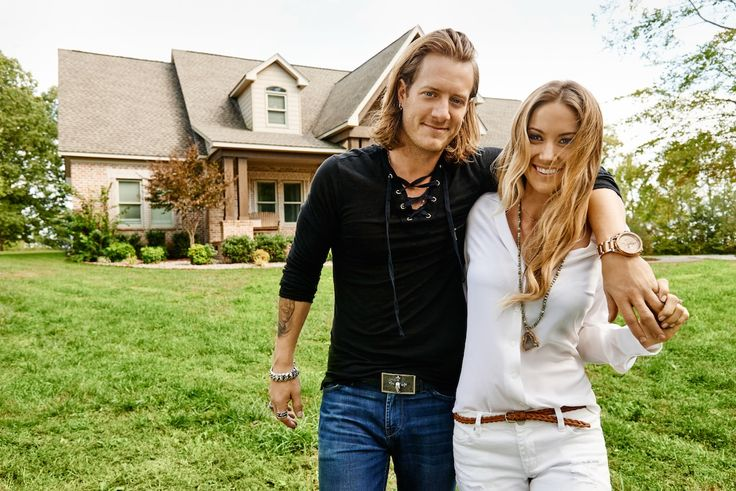 Tyler Hubbard and his fiancée, Hayley Stommel, in front of their four-bedroom home. Photo by Jeff Lipsky.