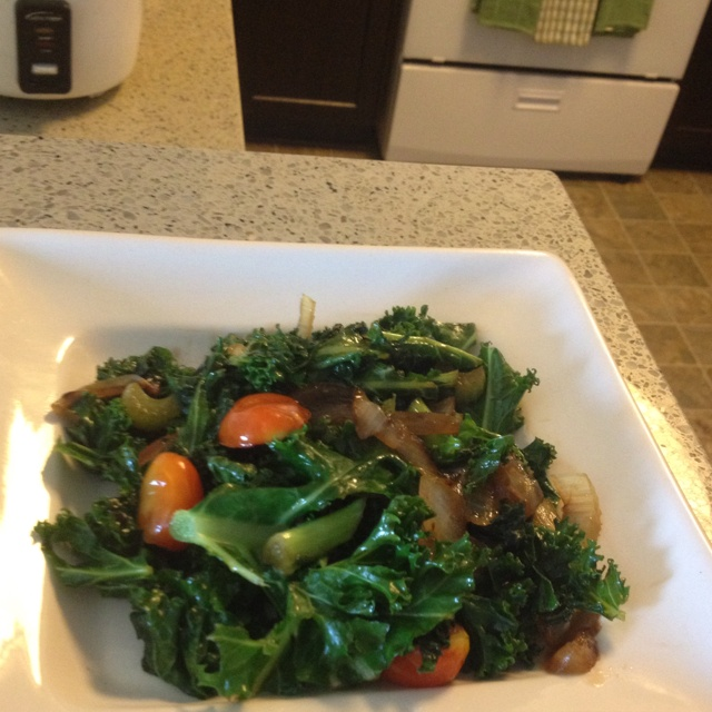 Sautéed kale with onions, celery, cherry tomatoes in olive oil and ...
