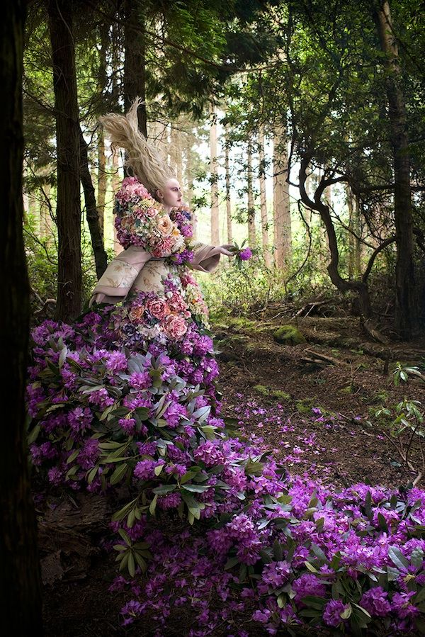 An incredible trail of 1,000 freshly cut flowers are in this latest scene by Kirsty Mitchell