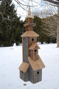 Unique Castle-like Birdhouse Exceptional hand crafted architectural style cedar roofs All reclaimed wood and cedar, no preservatives or stain used 6 different units to house 6 birds Access holes are 1 diameter, ideal for wrens Very sturdy and well-built Rust-free coated green wire for