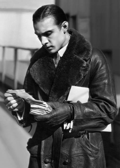rudolph valentino reading fan mail in a leather trench coat | 1920s | #vintage #1920s #fashion #menswear