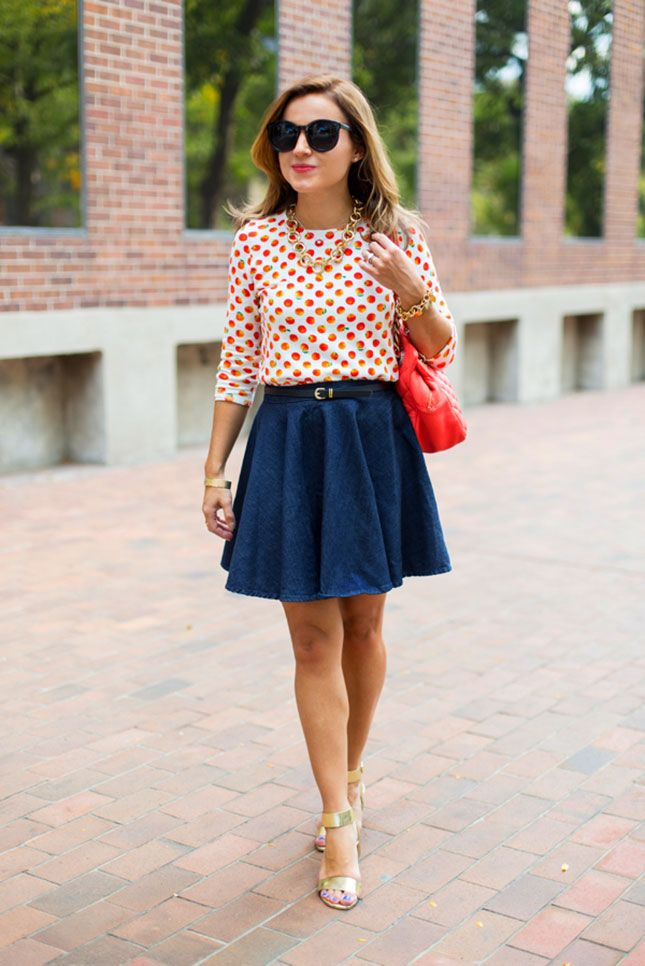 Pair a patterned top and denim skirt for this look.
