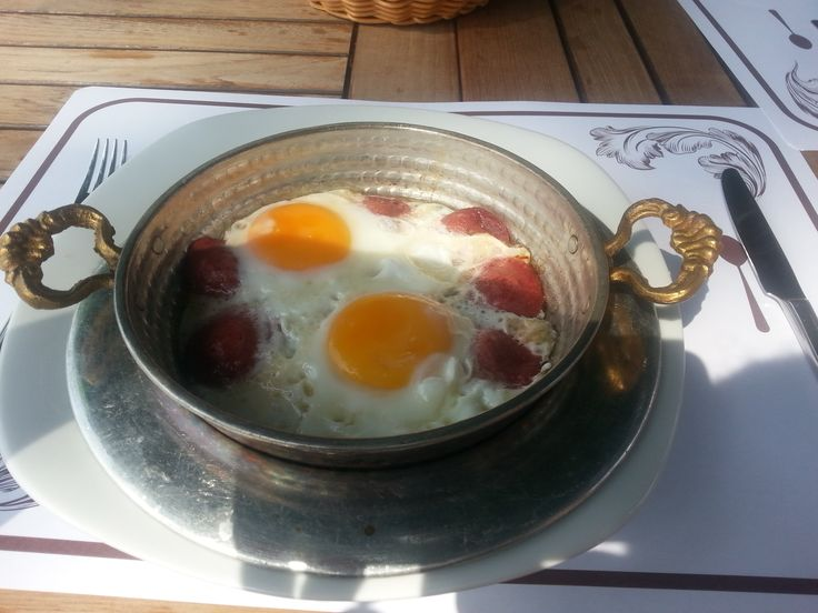 Typical Turkish Breakfast. Fried eggs with sucuk / sujuk.