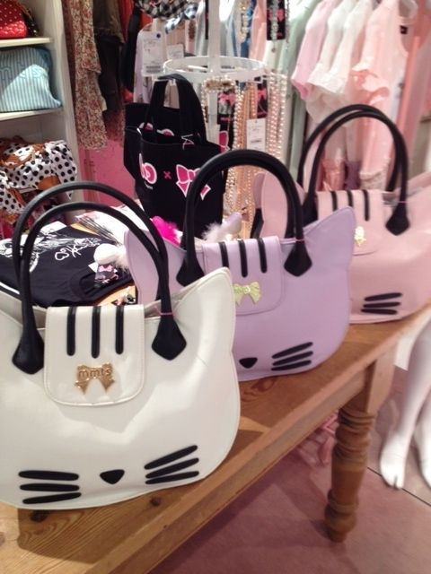 ❤ Japan  Kawaii ✖ Blippo ❤ cat purses!  For those who need to stash the cash they aren't spending on a significant other somewhere.  Anyway, they're cute.
