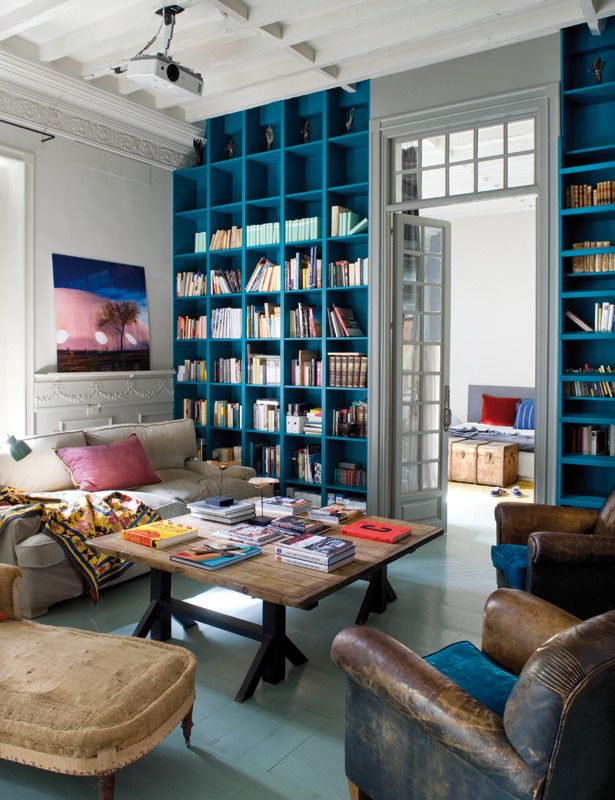 Colorful tall bookshelves - more than 13 feet high. They describe them as bringing a luxurious, spacious quality to the room.