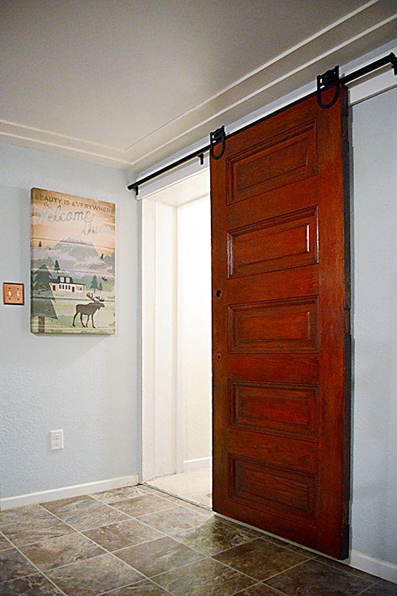 Rolling barn doors in action sliding barn doors master for Bedroom closet barn doors