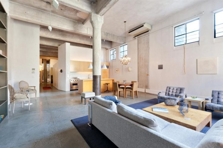 Loft : Two Floor Loft Idea with Three Bedroom in West Village New York City - Open Loft Living Area with Fabric Sofa and Tufted Arm Chairs and Wooden Dining Set also Simple Kitchen and Bar and Gray Ceramic Floor Tile and Great Pillars medium version